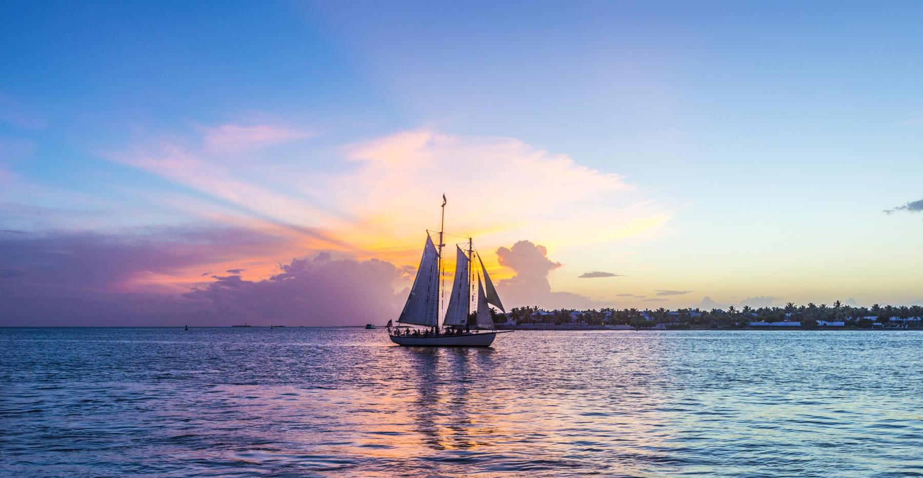Sailboat on the water at sunset