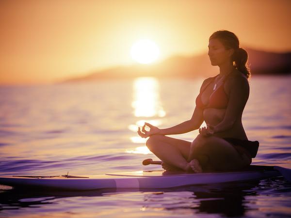 yoga asana on paddleboard